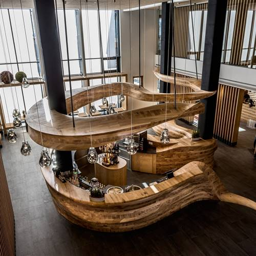 View of the unique wooden bar from above at Hotel Puradies