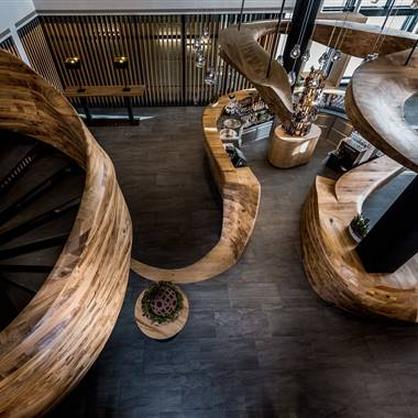View from above on the wooden bar and spiral staircase built from one piece